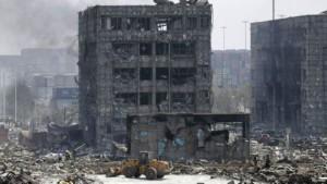 © Reuters Последствия взрыва складов в г. Тяньцзинь, Китай